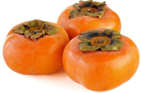 白い背景の上の 3 つの次郎柿 写真素材