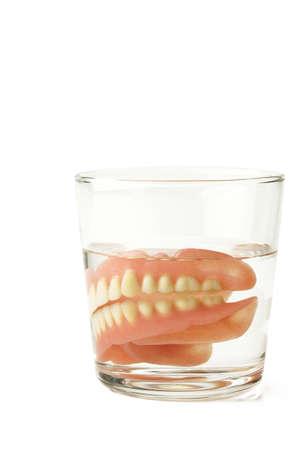 lower teeth: Full Denture, Dental plate in glass of water Stock Photo