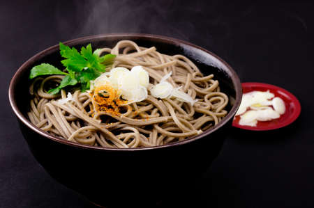 Japanese buckwheat noodles in hot soup photo