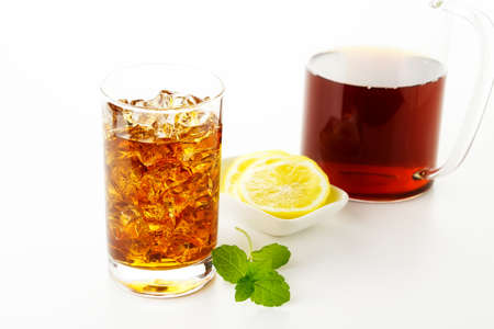 A glass of Ice tea on the white background photo