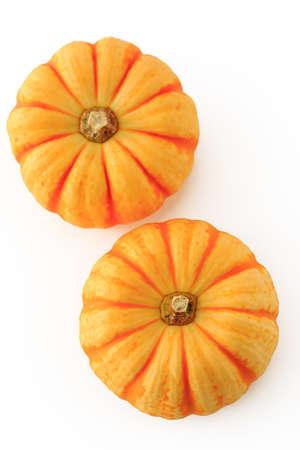 mini farm: Yellow pumpkin on the white background