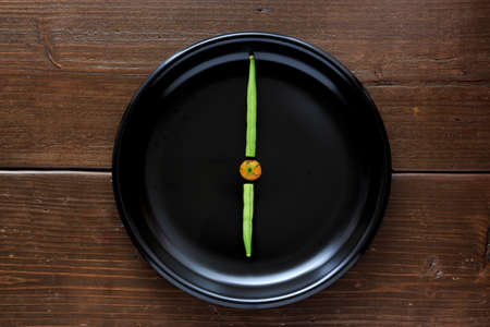 french bean: Clock made by vegetable Stock Photo