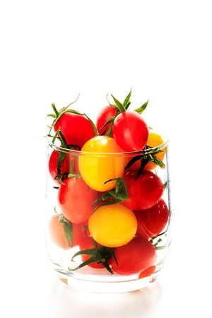 ガラスの多くのカラフルなトマト 写真素材