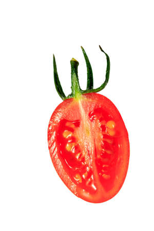 bisected: Bisected tomato on the white background