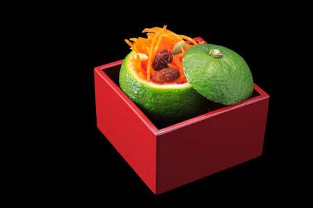 lacquer ware: Carrot namasu in green yuzu cup Stock Photo