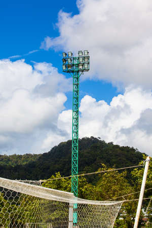 Spot-light tower for sport game with beautiful blue sky photo