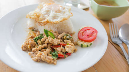 Fried basil leave with pork and Fried egg.