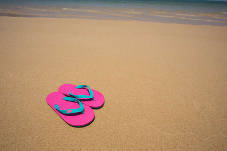 flipflop: flip-flop on the beach. Stock Photo