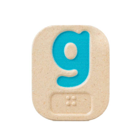 braille: alphabet g on white background  with Braille. Stock Photo