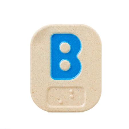 braille: alphabet B on white background  with Braille.