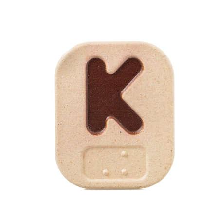 braille: K alfabeto sobre fondo blanco con Braille.
