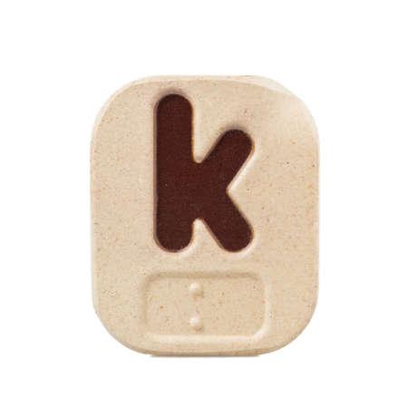 braille: k alfabeto sobre fondo blanco con Braille. Foto de archivo