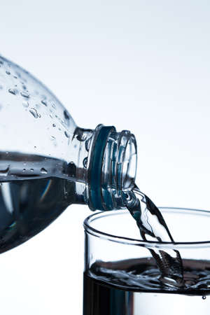 welling: pouring water from a bottle into glass.