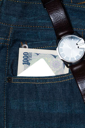 yen note: Card and  Japanese yen currency bank note in a back pocket of a denim jean.