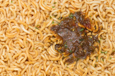 condiment: condiment Instant noodles cup, macro. Stock Photo
