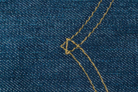 seams: Blue denim jeans texture with seams. Stock Photo