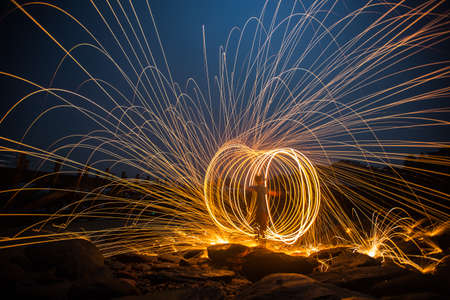 steel wool: Long exposure of steel wool begin of light. Stock Photo