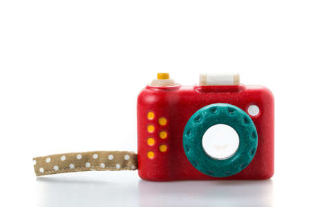 sharpness: wooden toy camera on white background.