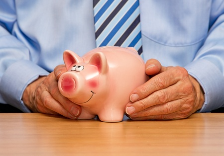 tax consultants: Man with Piggy Bank Stock Photo