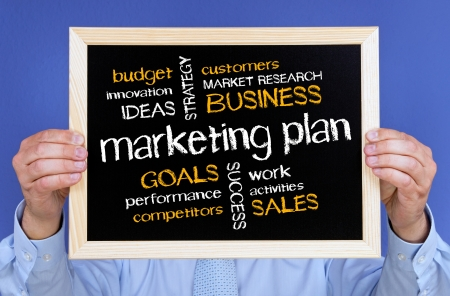 financials: Businessman with Marketing Plan Stock Photo