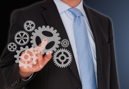 Businessman with Cogwheels Stock Photo - 18496468