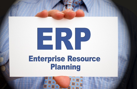 hand business card: ERP - Enterprise Resource Planning
