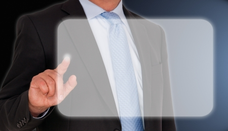 Businessman with touchscreen photo