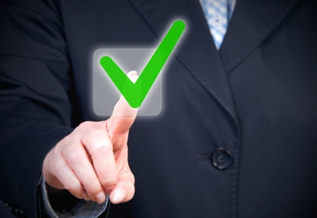approval button: Businesswoman with Checkbox Stock Photo