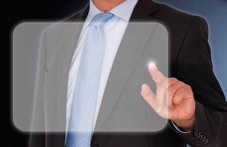 Businessman touching Display photo