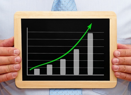 marketingplan: Sales Manager with Business Chart Stock Photo