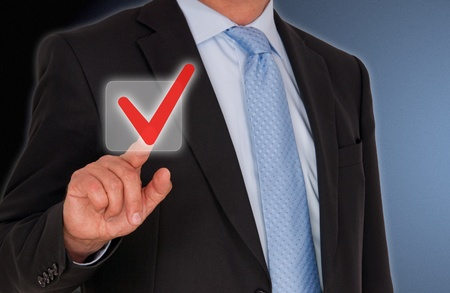 approval button: Man with red Checkbox Stock Photo