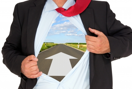 Businessman with Arrow on Road photo