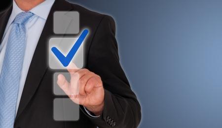 checkbox: Uomo d'affari con Casella blu
