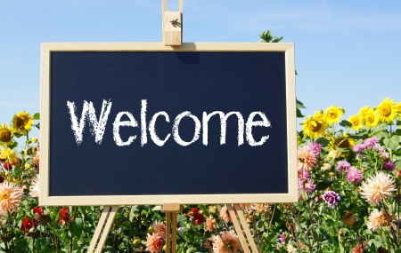 Welcome Chalkboard with Flowers photo