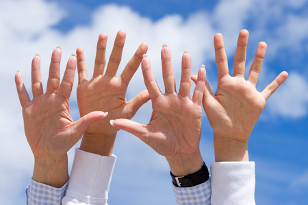 fundraising: Hands and blue Sky