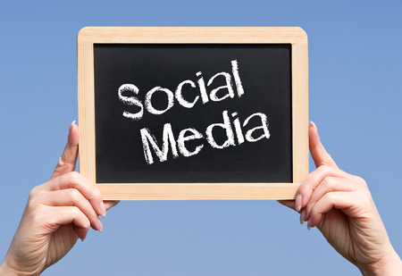 Social Media Chalkboard with Hands photo