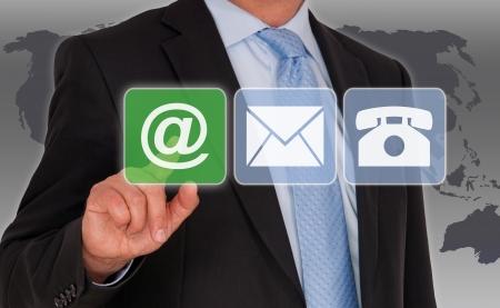 iconos contacto: P�ngase en contacto con nosotros por correo electr�nico Foto de archivo