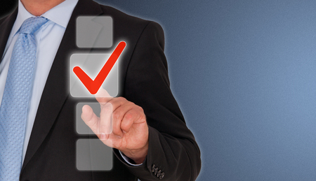 Businessman with red check box photo