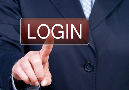 Login - Female Hand on Touchscreen Stock Photo - 23497960