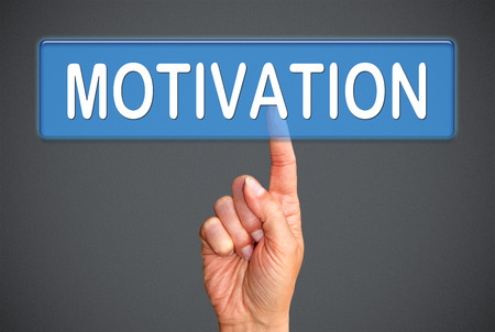 Finger touch the Motivation word photo
