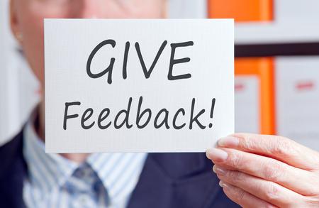 Geef feedback Stockfoto