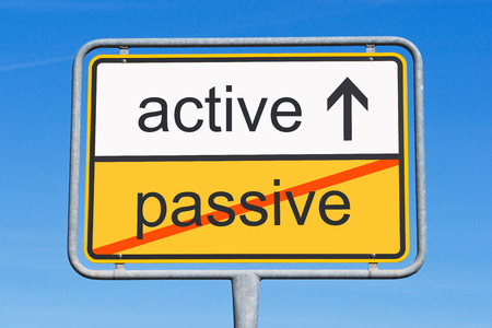 active instead passive word on road sign Stock Photo