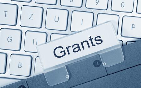 grants: Grants word on clip Stock Photo