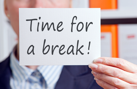 man holding text Time for a break photo