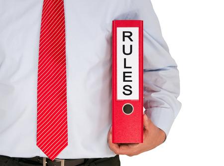 ルール - バインダーを持ったビジネスマン 写真素材