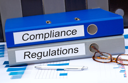 compliance: Compliance and Regulations Stock Photo