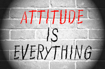 Attitude is everything words on brick wall Stock Photo