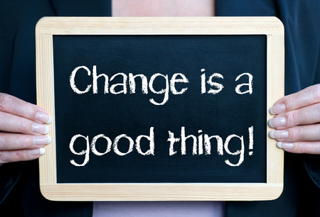 business decisions: Change is a good thing words on a board