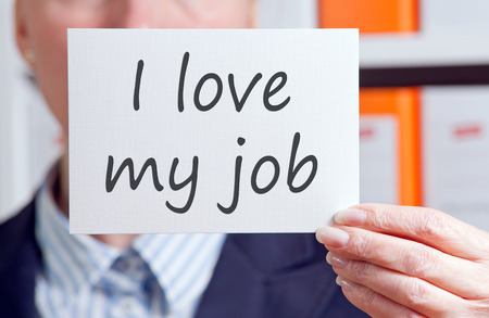 performances: I love my job note held by hand