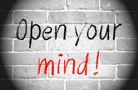 Open your mind words on brick wall Stock Photo